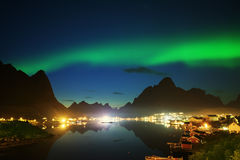 Nothern Lights and Reine, Lofoten Islands. Norway Royalty Free Stock Image