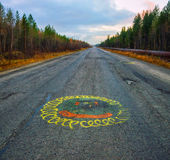Nothern road & Sun. The picture was taken in the north of Russia. Murmansk region royalty free stock image