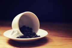 Cup with Coffee Beans 1. Nothing beats a strong cup of coffee to start a day! Here I put the espresso cup and saucer with some rich coffee beans to give a warm royalty free stock photography