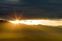 Shining Sun over clouds. Mountains and clouds shining open Royalty Free Stock Photography