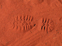 Nothing but footprints. Single bootprint in red desert sand in Australian outback royalty free stock images