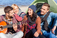 Nothing but friends and guitar. Royalty Free Stock Photo
