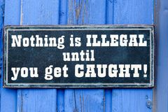 Nothing is illegal until you get caught plate royalty free stock photo