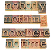 Nothing, nobody, nowhere, no time. Isolated words in vintage wood letterpress printing blocks stock images
