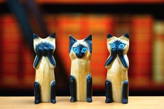 Nothing see, nothing hear, nothing talk cats figures Stock Photo