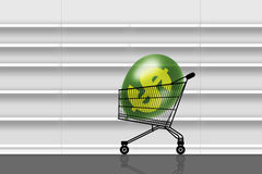 Nothing to buy in empty supermarket. Shopping caddy with a huge dollar balloon inside in front of empty shelves in a supermarket Royalty Free Stock Images