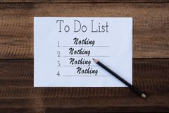 Nothing to do list on paper. to do list note on wooden background. Lifestyle concept royalty free stock image