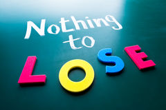 Nothing to lose. Conceptual words on blackboard Royalty Free Stock Photo