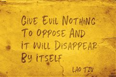 Nothing to oppose Lao Tzu. Give evil nothing to oppose and it will disappear by itself - ancient Chinese philosopher Lao Tzu quote printed on grunge yellow paper stock photography