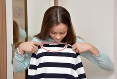 Teenage girl choosing her outfit stock image