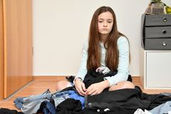 Frustrated teenage girl choosing her outfit royalty free stock photos