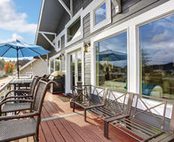 Nothwest traditional wooden deck with chairs and windows. Royalty Free Stock Image