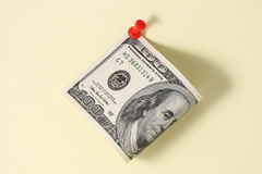Notice. One hundred dollar bill with red push pin Royalty Free Stock Photo