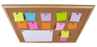 Notice board. Cork office notice board with blank colorful sticker notes isolated over white background (wideangle stock photos