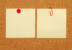 Notice board. Two blank pieces of paper on a cork board royalty free stock photography