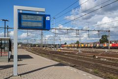 Notice board with departure times of trains at Dutch railway station of Amersfoort royalty free stock photos