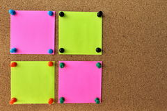 Notice board. Four papers on the Bulletin Board with the pins on your notes stock photos