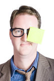Notice board man with blank paper message. Male administration assistant wearing work on face when mimicking an office notice board with blank copyspace Royalty Free Stock Photos