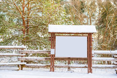 Notice board otdoor. At winter time, trees with snow Stock Photo