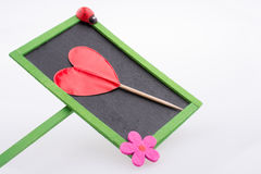 Notice board and red heart shape Stock Photos