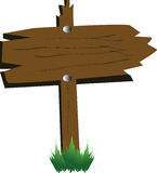 Notice board. Wooden notice board with grass on the background Stock Photography