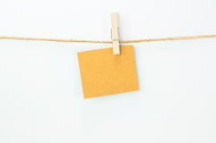 Notice card, brown paper and wood clips Royalty Free Stock Photography