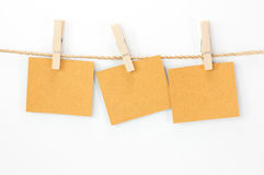 Notice card, brown paper and wood clips Stock Image