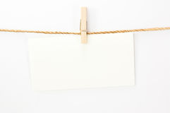 Notice card, white paper and wood clip Stock Photos