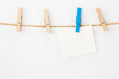 Notice card, white paper and wood clips Royalty Free Stock Image