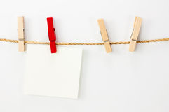 Notice card, white paper and wood clips Royalty Free Stock Images