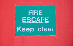 Notice on door: fire escape. Stock Image