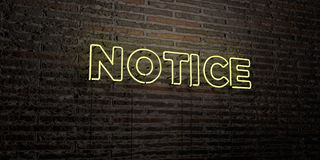 NOTICE -Realistic Neon Sign on Brick Wall background - 3D rendered royalty free stock image. Can be used for online banner ads and direct mailers Royalty Free Stock Photography