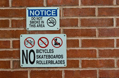 Notice sign no smocking, no bicycles, skateboards, rollerblades Royalty Free Stock Images