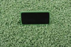 Noticeboard met kader op groen kleurenzand stock foto's