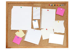 Noticeboard or pinboard. Empty paper, documents, photos and notes pinned onto a pinboard or noticeboard Stock Photography