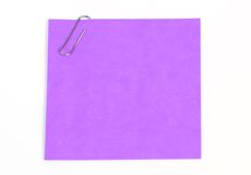 Notices. Isolated blue sticky note with paperclip royalty free stock photography