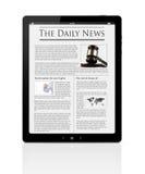 Noticias de asunto en la tablilla digital Foto de archivo libre de regalías