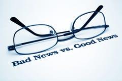 Noticias de las malas noticias vs.good Imagen de archivo libre de regalías