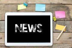 Noticias en la tableta Imagen de archivo libre de regalías