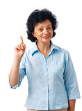 Notification. Portrait of a  happy senior woman pointing upwards on white Royalty Free Stock Photos