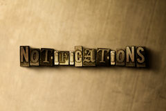 NOTIFICATIONS - close-up of grungy vintage typeset word on metal backdrop Stock Photo