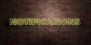 NOTIFICATIONS - fluorescent Neon tube Sign on brickwork - Front view - 3D rendered royalty free stock picture Royalty Free Stock Images