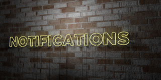 NOTIFICATIONS - Glowing Neon Sign on stonework wall - 3D rendered royalty free stock illustration Stock Image