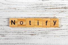 Free NOTIFY Word Made With Wooden Blocks Concept Royalty Free Stock Image - 100123336
