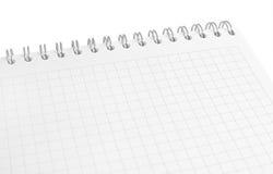Notitieboekje dat op witte achtergrond wordt geïsoleerdd stock foto