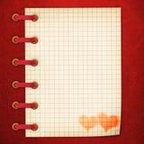 Notitieboekje in de rode dekking Royalty-vrije Stock Afbeeldingen