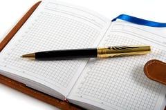 Notitieboekje en ballpoint Stock Afbeeldingen