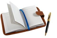 Notitieboekje en ballpoint. Royalty-vrije Stock Foto