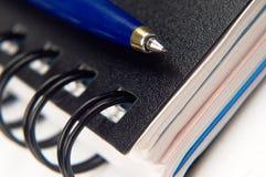 Notitieboekje en een pen Stock Fotografie
