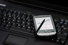 Notitieboekje en PDA royalty-vrije stock afbeeldingen